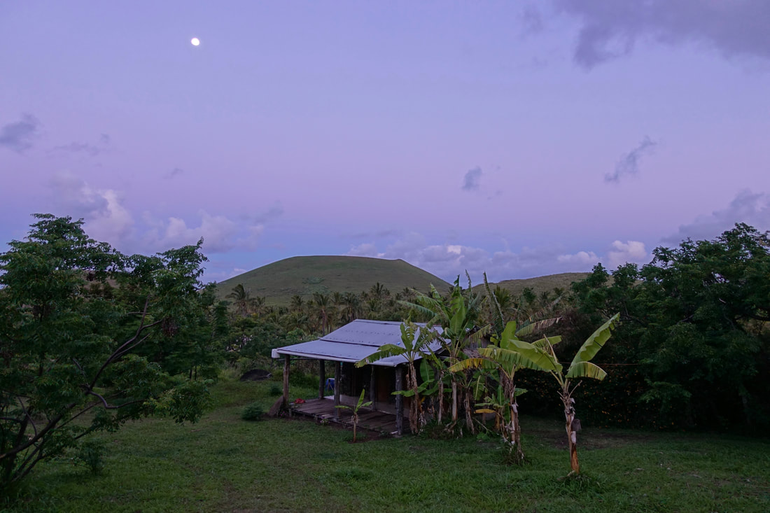 Anakena campground at dusk with a full moon