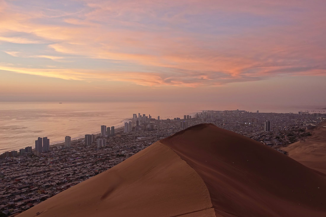 Sunset above the city of Iquique on Cerro Dragon