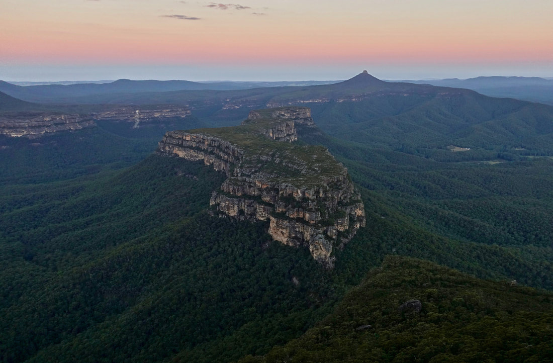 Pigeon House and Byangee Mountain from the Castle at sunset in the Budawangs in Australia
