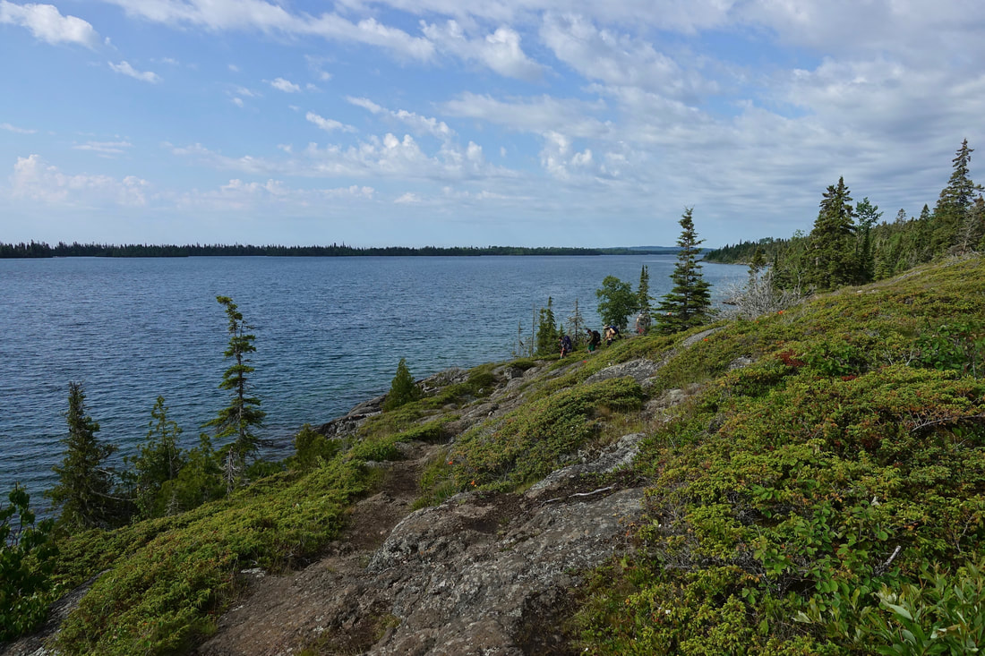 Hiking along the Three mile trail in Isle Royale Michigan